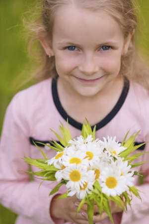 sincere girl: natural portrait of one cute little girl looking above and smiling