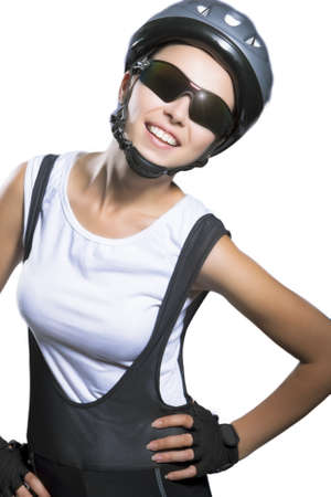 beautiful portrait of caucasian female bike athlete with brilliant smile wearing  professonal sportswear. isolated over pure white background. vetical shot photo