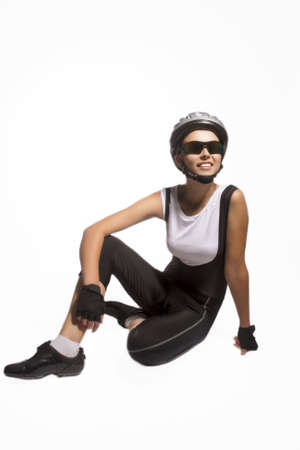portrait of professional female bike athlete sitting and smiling.isolated over pure white background. vertical image photo