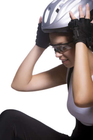portrait of professional female bike athlete sitting and fixing her protective helmet. vertical image photo