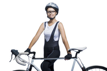 portrait of young caucasian sportswoman professionally equipped standing with bicycle isolated over white  horizontal shot photo