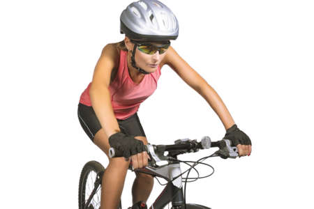 professional female cycling athlete riding mountain bike and equipped with professional bike gear isolated over white background. horizontal shot photo