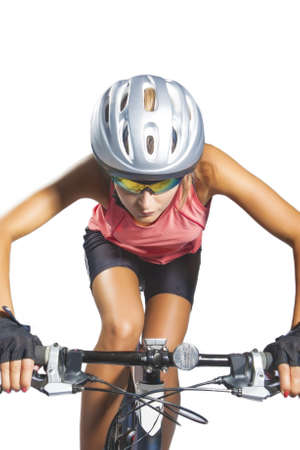 female cycling athlete riding mountain bike and equipped with professional bike gear isolated over white. vertical shot