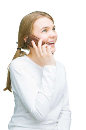 portrait of young teenage girl talking on mobile phone. isolated on pure white background. vertical shot Standard-Bild