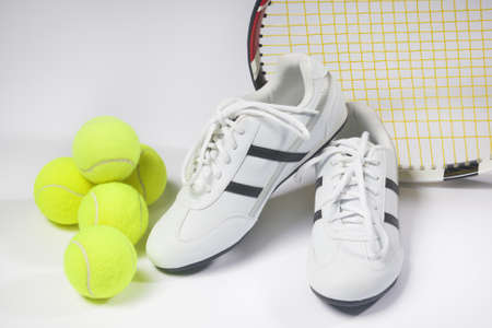 raquet: Tennis sports Concept: Raquet, Balls and Sneakers against white. Horizontal Image Stock Photo