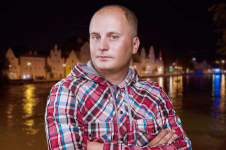 odin: Portrait of a Tanned Man in Night City. Composite Image. Horizontal Shot
