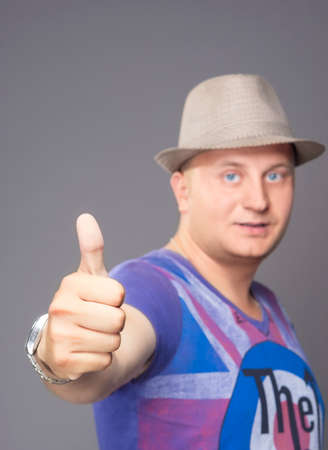 thumbsup: Portrait of Young Man Showing Thumbs up isolated over Gray. Vertical Image