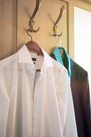 man's shirt: Mans Shirt and Suit Hanging Together On Hangers. Vertical Image