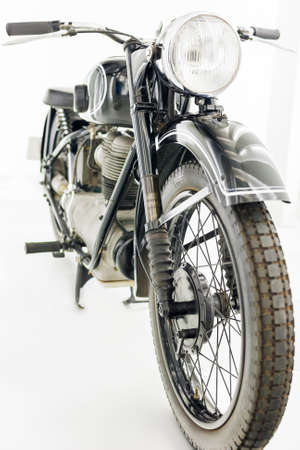 Old Motorcycle Isolated Over white Background  Vertical Image Stock Photo