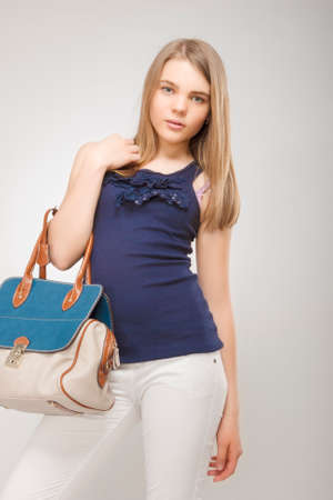 caucasian girl: Portrait of Teenage Caucasian Girl with Fashion Bag  Isolated Over Gray  Vertical Image