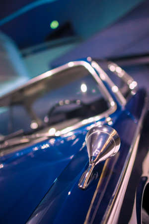 Munich, Germany- june 17, 2012: BMW Round Shape Mirror of Old Fashioned Sedan on Display in BMW Museum in June 17, 2012, Munich, Republic of Germany. Vertical Image