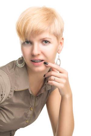 Young Caucasian Woman Showing Her Teeth Brackets. photo