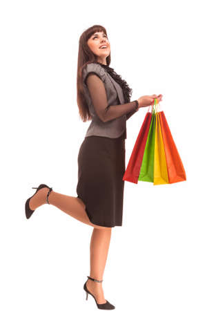 exclaiming: Shopping Concept: Happy Exclaiming Caucasian Woman With Color Bags. Isolated Over White. Vertical Image