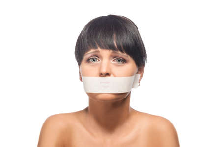 Family Violence Concept: Portrait of Brunette Woman with Her Mouth Sealed with Tape. Isolated Over White Background. Horizontal Image photo