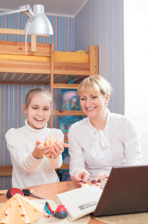 Family Together Making Paper Cratfs. Indoors Setting. Vertical Image