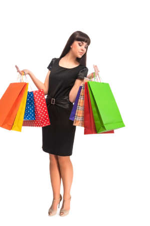 estimating: Shopping Concept: Brunette Caucasian Woman  Estimating Shopping bags. Isolated Over White Background. Vertical Image Stock Photo