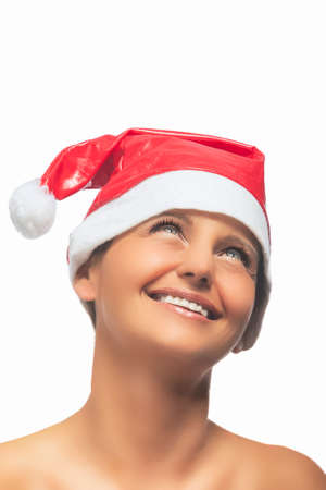portrait of Cacuasian Brunette Woman In Santa Hat Isolated Over White Background. Vertical Image photo