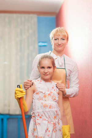 13 15 years: Mother and Daughter doing Tidy Up Together  Indoors Shoot  Vertical Image Stock Photo
