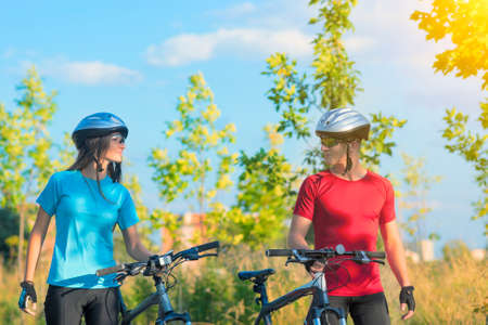Loving Sensual Caucasian Couple with Bicycles Walking Outdoor. Horizontal Image Composition photo