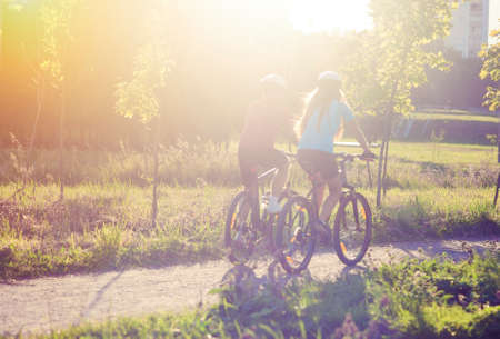 Back side of Two Cycling Athlets Riding Outdoor  Horizontal Image Stock Photo