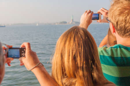 aboard: People Taking Pictures of the Statue of Liberty from Aboard  Horizontal Image