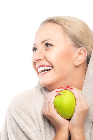 Dental Health Concept: Portrait of Young  Smiling Caucasian Woman With Green Apple in Hands. Vertical Image. Isolated Over White Background