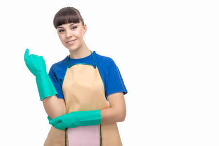 Cleaning Concept: Adorable Caucasian Female Cleaner with Protective Rubber Gloves On. Horizontal Image