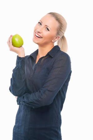 causasian: Dental Health Concept: Causasian Blond Female with Green Apple in Front of Her Mouth. Isolated over Pure White Background. Vertical Image