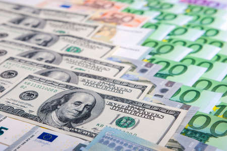 credit union: Currency Concept: Closeup of European and the US Hard Currencies Together. Horizontal Image