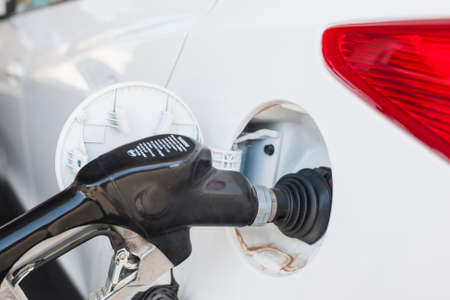 refilling: Refilling Car Tank at Fuel Station. Horizontal Image Composition Stock Photo