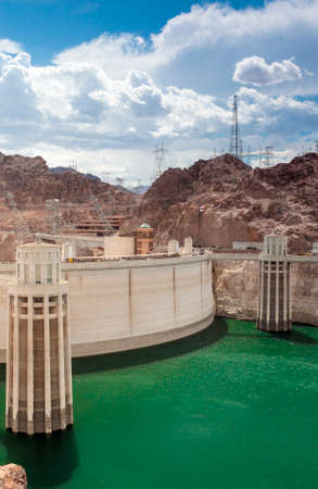 hoover dam: Hoover Dam and Penstock Towers in Lake Mead of the Colorado River on the Border of Arizona and Nevada States. Vertical Image Orientation