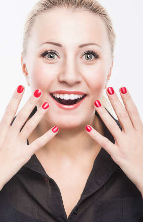 arcane: Portrait of Surprised Excited Caucasian Woman against Pure White Background. Model with Fascinated and Joyful Facial Expression. Vertical Image Composition Stock Photo
