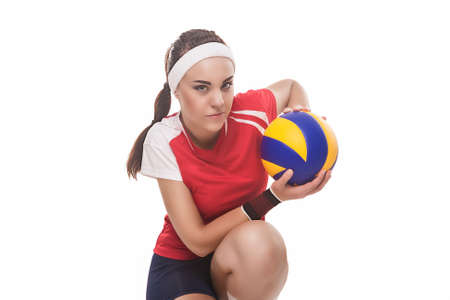 volleyball serve: Professional Female Volleyball Player Sitting With Ball. Isolated Over Pure White Background. Horizontal Image