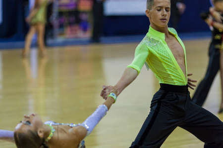 Minsk-Belarus, October 4,2014: Unidentified Professional dance couple performs Youth-2 Latin-American program on World Open Minsk-2014 WDSF Championship in October 4, 2014 in Minsk, Republic Of Belarus