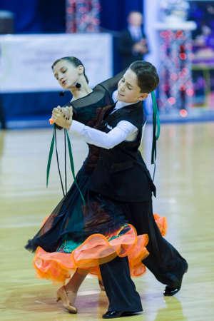 Minsk-Belarus, October 4,2014: Unidentified Dance couple performs Juvenile-1 Standard European program on World Open Minsk-2014 WDSF Championship in October 4, 2014 in Minsk, Republic Of Belarus