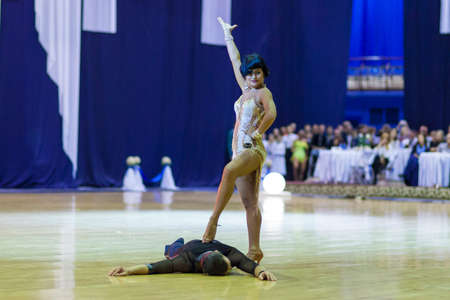 finalist: Minsk-Belarus, October 4, 2014: Andrey Zaycev and Elizaveta Cherevichnaya (Russian Federation) perform Latin-American Program Exhibition Performance on on World Open Minsk-2014 WDSF Championship in October 4, 2014 in Minsk, Republic Of Belarus