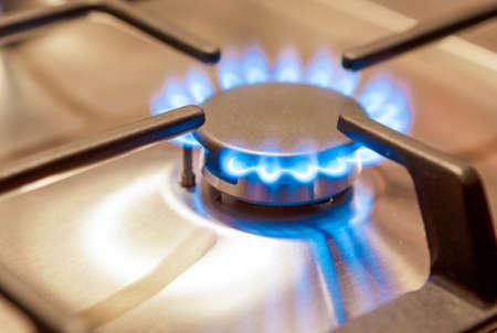 Closeup Shot of Gas Burner on Stove Surface. Horizontal Image