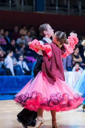 gold standard: Minsk-Belarus, December 20,2014: Gritcan Artem and Zagrebailova Yana perform Juvenile-1 Standard European program on Gold of The Capital International IDSA Tournament on December 20, 2014, in Minsk, Republic of Belarus