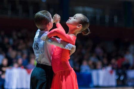 Minsk-Belarus, December 20,2014: Ivanov Nikita and Gurova Evgeniya perform Juvenile-1 Standard European program on Gold of The Capital International IDSA Tournament on December 20, 2014, in Minsk, Republic of Belarus