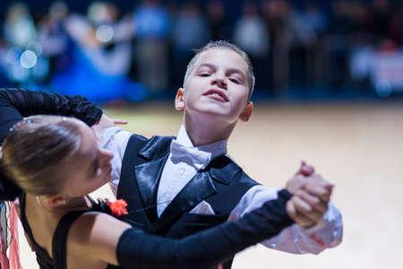 gold standard: Minsk-Belarus, December 20,2014: Tchizhik Svyatoslav and Lepko Veronika perform Juvenile-1 Standard European program on Gold of The Capital International IDSA Tournament on December 20, 2014, in Minsk, Republic of Belarus Editorial