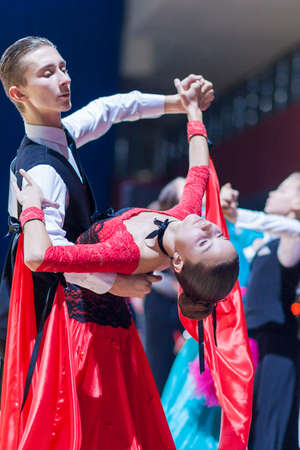 gold standard: Minsk-Belarus, December 20,2014: Oleshkevich Daniil and Bashlaminova Olga perform Juvenile-1 Standard European program on Gold of The Capital International IDSA Tournament on December 20, 2014, in Minsk, Republic of Belarus