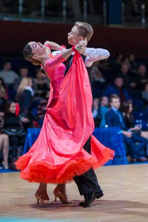 gold standard: Minsk-Belarus, December 20,2014: Radkevich Nikita and Hut Evgeniya perform Juvenile-1 Standard European program on Gold of The Capital International IDSA Tournament on December 20, 2014, in Minsk, Republic of Belarus