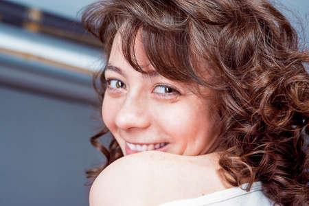 arcane: Smiling Happy Charming Cute Caucasian Female with Beautiful Dark Curly Hair. Horizontal Image