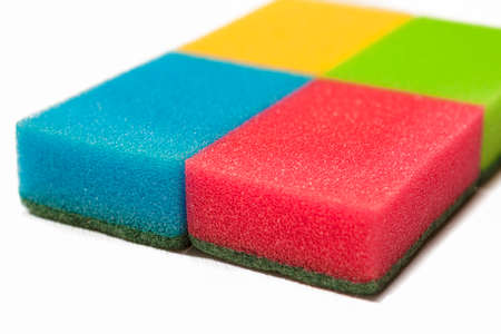 bright housekeeping: Houseware Concept: Four Colorful Kitchen Sponges Together. Isolated Over White Background. Horizontal Image Orientation