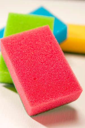 bright housekeeping: Pile of Kitchen Colorful Sponges On White Surface. Vertical Image Composition