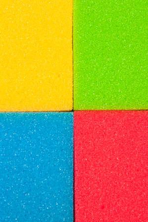 houseware: Houseware Concept. Closeup of Four Colorful Kitchen Sponges. Vertical Image Composition Stock Photo