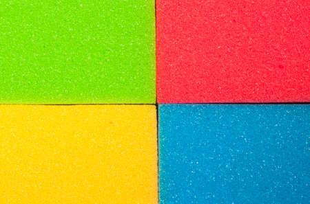 houseware: Houseware Concept. Closeup of Four Colorful Kitchen Sponges. Horizontal Image Composition