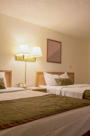 kingsize: Hotel Bedroom with Two Beds. Vertical Image Composition