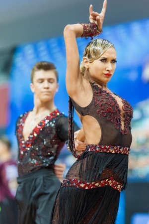 latinamerican: Minsk, Belarus-February 14,2015: Unidentified Professional Dance Couple Performs Youth-2 Latin-American program on IDSA World Professional 10 Dance Championship on February 14, 2015, in Minsk, Republic of Belarus Editorial