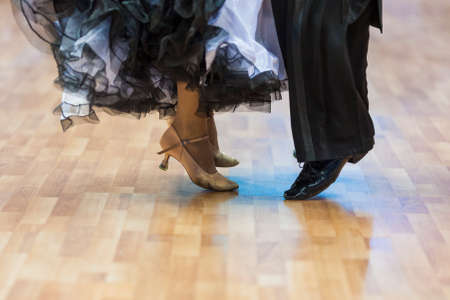 Closeup of Legs of the Professional Dance Couple Performing European Standard Program.Horizontal Image Composition Stock Photo